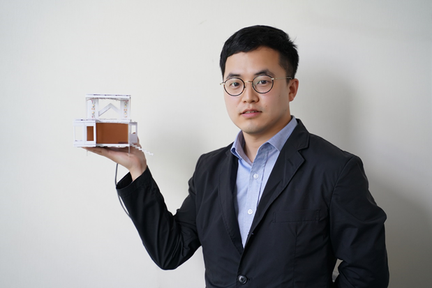 Yuan Gao and his demonstration house model