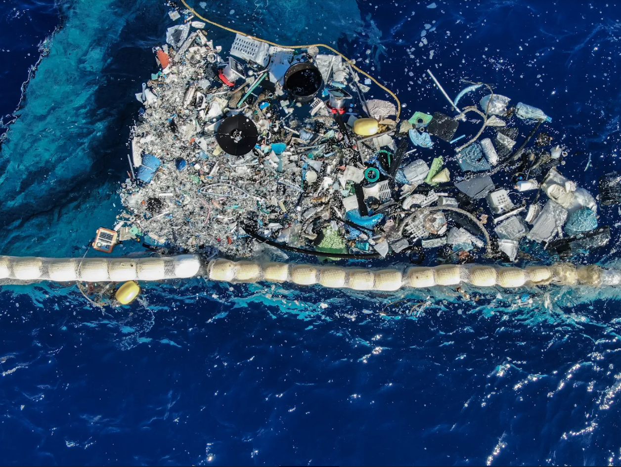 Evolving Methodologies, photo of sea with rubbish floating on the surface of the water.